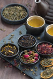 Assortment of fragrant dried teas and green tea, top view Royalty Free Stock Photos