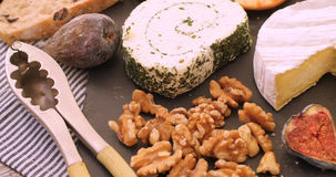 An assortment of French and British cheese with figs and walnuts Stock Photography