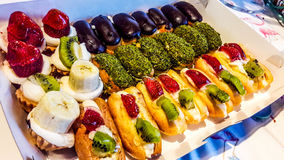 Assortment of French Dessert Eclairs in white box. royalty free stock image