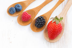 Assortment of fresh berries in a wooden spoon, top view Stock Photo