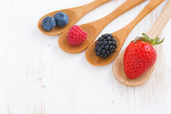 Assortment of fresh berries in a wooden spoon Stock Image