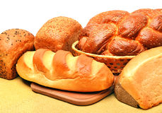 Assortment of fresh bread on the tablecloth Royalty Free Stock Photo
