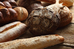 Assortment of fresh bread on a wooden background Stock Image