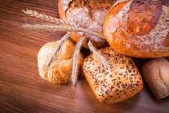 Assortment of fresh bread. On wooden table Stock Image