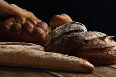 Assortment of fresh bread on the wooden table Royalty Free Stock Images