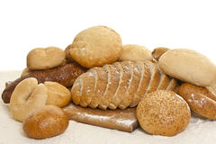 Assortment of fresh breads with flour Stock Photography