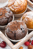 Assortment of fresh delicious muffins and fresh berries Stock Photo