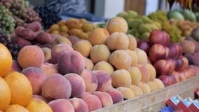 Assortment of fresh fruits at market. Assortment of fresh fruits. Fresh fruits at a market stock video footage