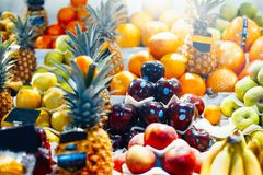 Assortment of colorful fresh fruits at market. Concept of natural and fresh food royalty free stock images