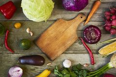 Assortment of fresh fruits and vegetables with cuttind board on royalty free stock image