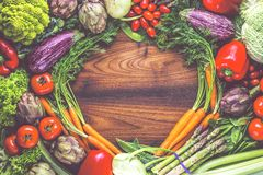 Assortment of fresh fruits and vegetables wooden background. stock images