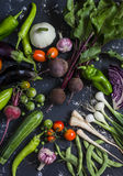 Assortment of fresh garden vegetables on dark background. Stock Photography