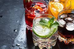 Assortment of fresh iced fruit drinks on a black background Royalty Free Stock Image