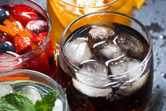 Assortment of fresh iced fruit drinks on a dark background Stock Photos