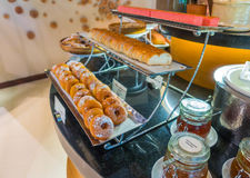 Assortment of fresh pastry on table in buffet . Royalty Free Stock Images