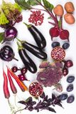 Assortment of fresh raw purple homegrown vegetables on white table. Cauliflower eggplant  beets  carrots  potatoes  plums  basil  onions garlic, beans  lettuce Stock Photos