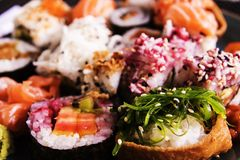 Assortment Fresh Sushi Rolls on Plate Seaweed Focus royalty free stock photo