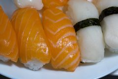 Assortment of fresh sushi, sushi with salmon and butterfish. Tasty fresh japanese cuisine. Asian food. Susi. royalty free stock photography