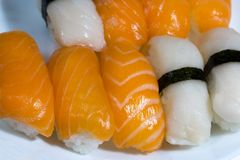 Assortment of fresh sushi, sushi with salmon and butterfish. Tasty fresh japanese cuisine. Asian food. Susi. royalty free stock photos