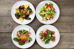 Assortment of fresh vegetable salads flat lay. royalty free stock photography