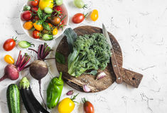 Assortment of fresh vegetables. Food background. Broccoli, tomatoes, peppers, zucchini, eggplant on a light background, top view. Flat lay Royalty Free Stock Photos