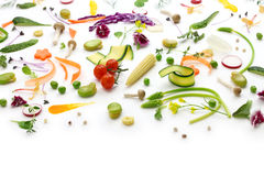 Assortment fresh vegetables. Fresh herbs, vegetables and edible flowers collection, healthy salad preparation Stock Photos