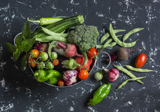 Assortment of fresh vegetables in a metal basket Royalty Free Stock Images