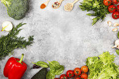 Assortment of fresh vegetables pepper, cherry tomatoes, onions,. Garlic, broccoli, avocado, spinach, parsley, fennel and spices on a light background. Top view Royalty Free Stock Image