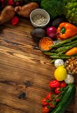 Assortment of fresh vegetables on wooden background.  stock images