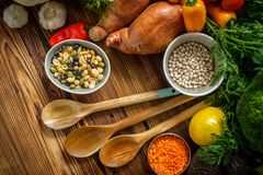 Assortment of fresh vegetables on wooden background.  royalty free stock image