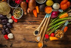 Assortment of fresh vegetables on wooden background.  royalty free stock images