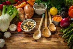 Assortment of fresh vegetables on wooden background.  royalty free stock photos