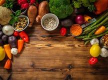 Assortment of fresh vegetables on wooden background.  stock image