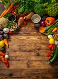 Assortment of fresh vegetables on wooden background.  royalty free stock photo