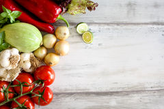 Assortment of fresh vegetables on wooden background Royalty Free Stock Photo