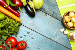 Assortment of fresh vegetables on wooden background Royalty Free Stock Images