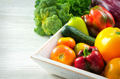 Assortment of fresh vegetables on wooden table. Assortment of fresh vegetables close up photo Stock Images