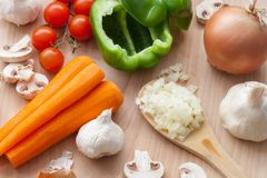 Assortment of fresh vegetables on a wooden table/soup preparation stock photos