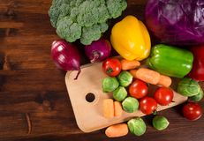 Assortment of fresh vegetales on wooden table with copyspace. Assortment of fresh vegetales on wooden table, empty space for text Stock Photo