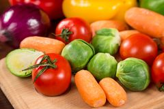 Assortment of fresh vegetales on wooden table. Healthy nutrition background Stock Photography