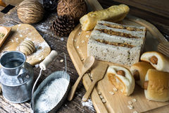 Assortment freshly baked bread rolls lightly dusted with flour on a wooden. Table top Stock Photos