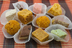 Assortment of Freshly Prepared Indian Sweets. An assortment of freshly prepared Indian sweets that are traditional holiday treat on Diwali day and are normally stock photos