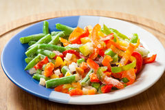 Frozen vegetables on the plate Royalty Free Stock Photo