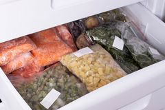 Assortment of frozenVegetables in home fridge. Frozen food in the refrigerator. Assortment of frozenVegetables in home fridge. Frozen food in the freezer Stock Photo