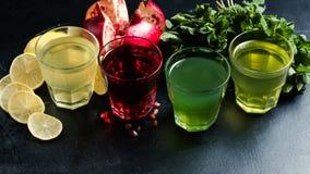 Assortment georgian nonalcoholic refreshing drinks. Assortment of Georgian nonalcoholic drinks. Pomegrante juice, lemonade, tarkhun and mint refreshing beverages Royalty Free Stock Photos