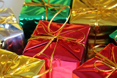 Assortment of gifts space. Assortment of gifts gold, silver, red, & green royalty free stock photos