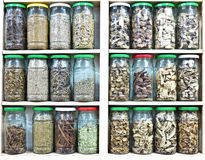 Assortment of glass jars with herbs and spices Royalty Free Stock Photos