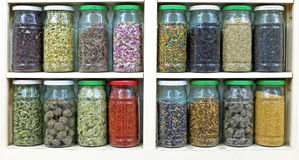 Assortment of glass jars on shelves in herbalist shop in marrake. Sh, morocco, containing herbs and spices for medicinal and culinary purposes Stock Images