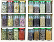 Assortment of glass jars on shelves in herbalist shop in marrake Stock Photos
