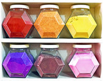 Assortment of glass jars on shelves in herbalist shop in marrakesh Stock Photos